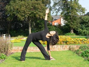 Trikonasana, also known as the Triangle Pose is useful for strengthening the legs and spine.